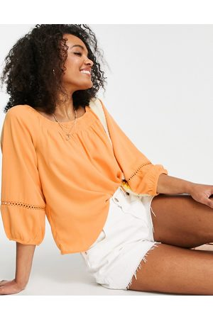 JDY Off the shoulder top with lace cut work in orange