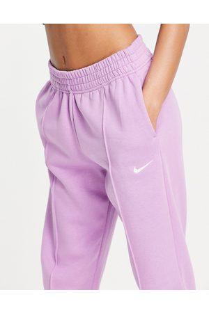 Nike Mini swoosh oversized jogger in violet purple