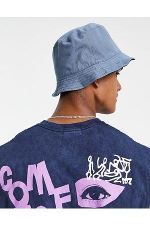 SVNX Hombre Sombreros - Reversible bucket hat