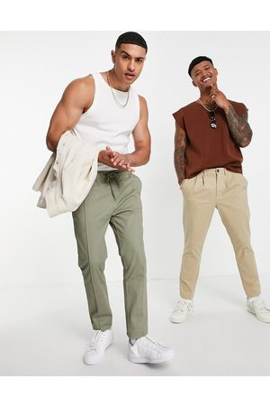 ASOS Hombre Chinos - Skinny chinos with elasticated waist and pin tuck in light khaki