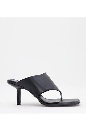 Raid Mujer Zuecos - Evia toe post mules in black