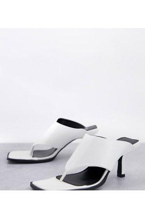 Raid Wide Fit Evia toe post mules in white