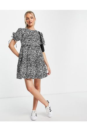 Influence Mujer Casuales - Tiered mini dress in animal print