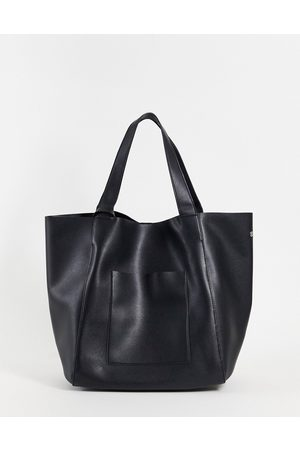 ASOS DESIGN Oversized tote bag in black faux leather with detachable wallet