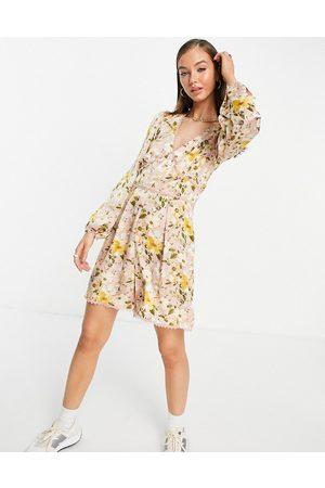 VILA Long sleeve playsuit in floral print