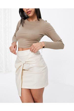 NaaNaa PU front twist skirt in cream