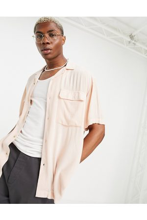 ASOS Crinkle viscose shirt with revere collar and pockets in pink