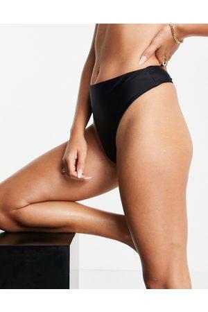 We Are We Wear Mix and match recycled high leg high waist thong bikini bottom in black