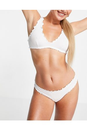 Weekday Naomi recycled triangle soft bra with ruffle edge in white