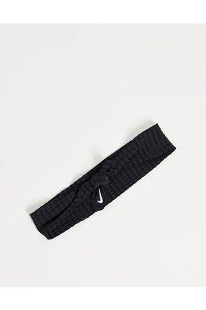 Nike Head tie skinny in black
