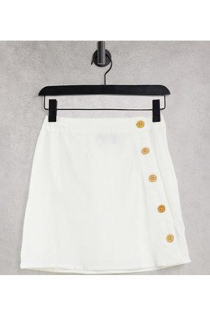 ASOS Petite ASOS DESIGN Petite linen look mini skirt with asymmetric button detail in white