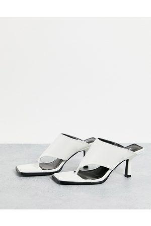 Raid Evia toe post mules in white