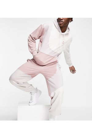 Puma Convey joggers in pink colorblock exclusive to ASOS