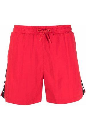 Fila Shorts de playa con franjas del logo