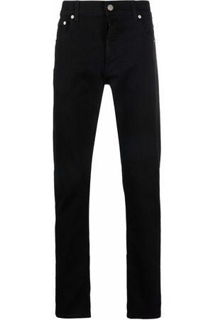 Alexander McQueen Jeans slim con logo estampado
