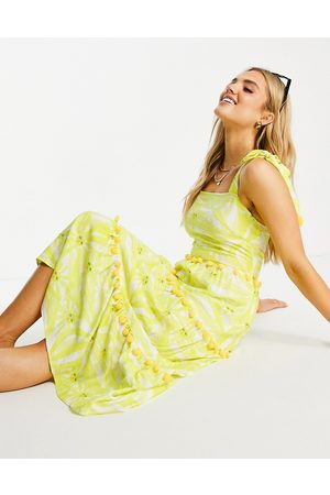 Never Fully Dressed Tiered midi sun print dress with pom pom details in yellow