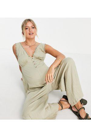 ASOS ASOS DESIGN maternity button front lace trim swing jumpsuit in khaki