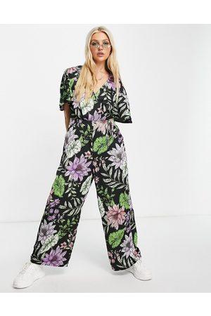 Liquorish Wrap jumpsuit in tropical flower print