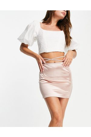 Flounce London Satin mini skirt with strap details in mink
