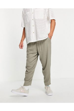 ASOS Oversized tapered lightweight trousers with elasticated waist in khaki