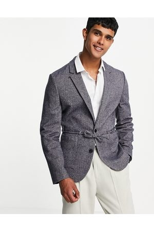 ASOS DESIGN Skinny blazer in navy wool mix herringbone with belt detail
