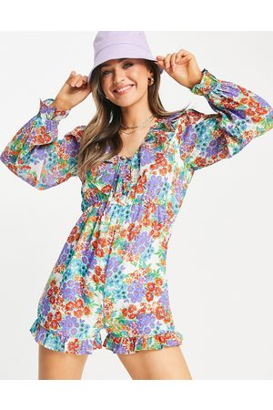 Influence Ruffle playsuit in multi floral