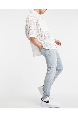 ASOS Cone Mill Denim skinny fit 'American classic' jeans in vintage light wash with rips