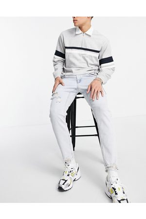 ASOS Hombre Skinny - Stretch slim jeans in 90's bleach wash with rips