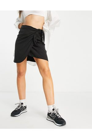 & OTHER STORIES Wrap front mini skirt in black