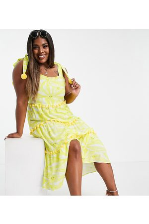 Never Fully Dressed Mujer Midi - Tiered midi sun print dress with pom pom details in yellow