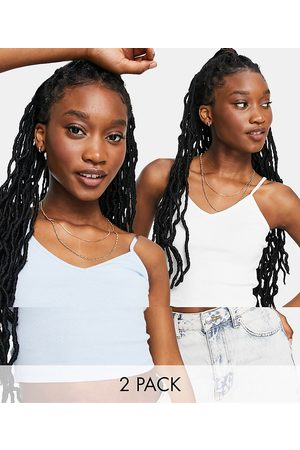 Monki Tricia 2 pack cropped vest in white and blue