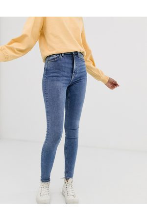 Weekday Organic cotton blend high waisted skinny jeans in mid blue