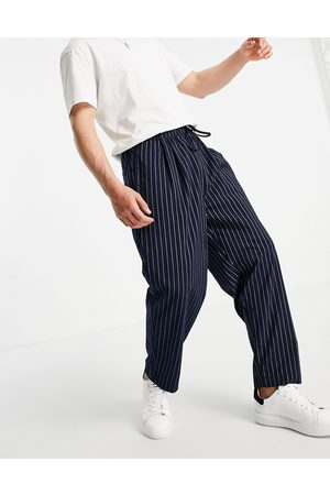 ASOS DESIGN Wide leg trousers with pleats in navy pin stripe