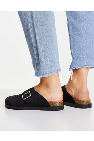 Schuh Valencia leather suede clogs in black