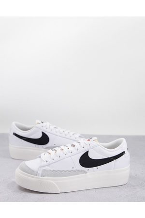 Nike Blazer Low Platform trainers in white and black