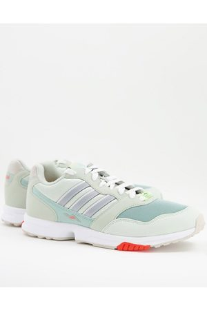 adidas ZX 1000C trainers in pale green