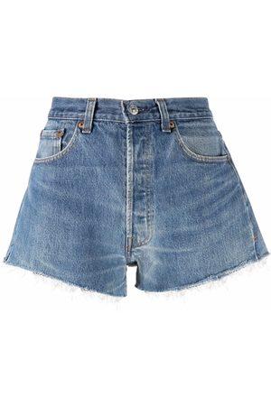 RE/DONE Shorts de mezclilla con bordes sin rematar
