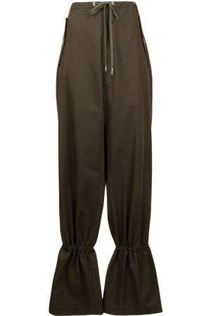DION LEE Pantalones ajustados con lazo y ojales