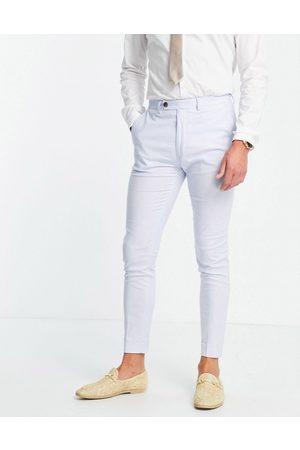 ASOS DESIGN Wedding super skinny suit trousers in pastel blue cotton linen