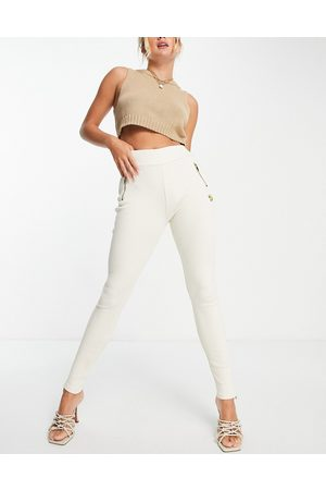 The O Dolls Collection ODolls Collection zip detail ribbed legging co ord in cream