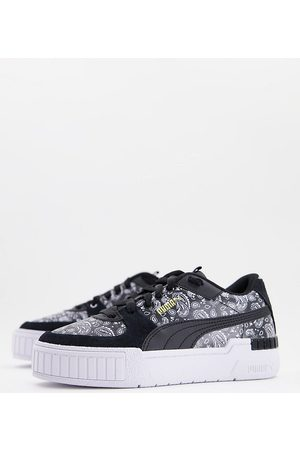 PUMA Cali Sport trainers in black and paisley print