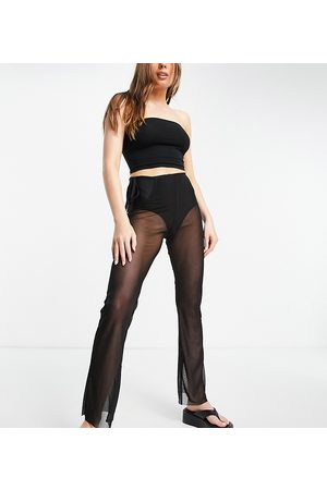 COLLUSION Highwaisted mesh flares in black