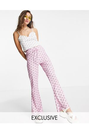Reclaimed Inspired flares in lilac floral print