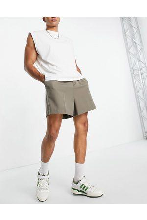 ASOS DESIGN Cropped bermuda smart shorts in green