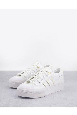 adidas Originals Nizza Platform trainers in triple white