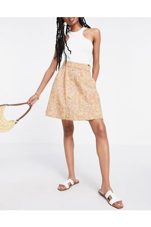 Y.A.S Organic cotton button front mini skirt in yellow floral