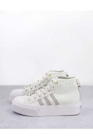 adidas Originals Nizza Platform hi top trainers in white and grey