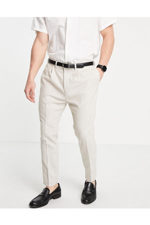 ASOS DESIGN Super skinny suit trousers in stone neppy basketweave