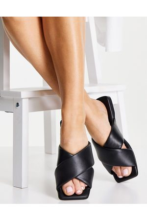 Schuh Tania leather cross front slide in black