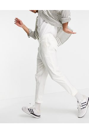 ASOS Tapered smart trousers in cream linen